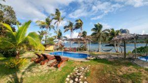 Small pool, beach chairs and hammock on the beach, Fiji