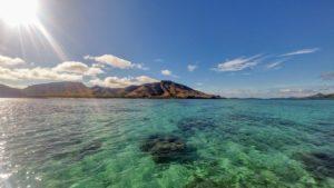 Island in the sea and mainland on the horizon, Fiji