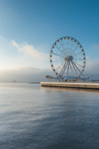 Azerbaijan, Baku, Bulvar Promenade,  Baku Eye Ferris Wheel with morning fog, dawn