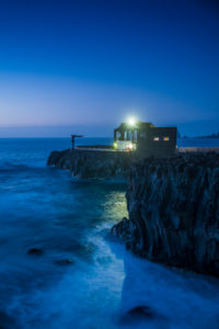 Spain, Canary Islands, El Hierro Island, Las Puntas, Hotel Puntagrande, listed in the Guinness Book of World Records as the smallest hotel in the world, dusk