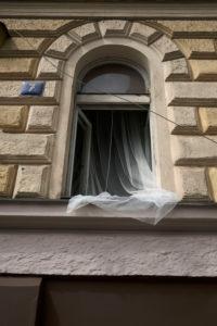 Europe, Czech Republic, Prague, house facade, detail, open window, curtain