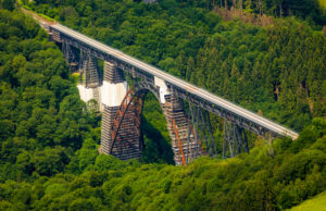 Aerial view of the railway bridge Müngstener Bridge formerly Kaiser Wilhelm Bridge is the highest railway bridge in Germany over the Wupper is being renovated in Solingen in the German state of North Rhine-Westphalia, Germany, Rhineland, Europe, Germany's highest railway bridge, historic railway bridge, iron bridge