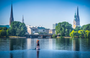 Germany, Hamburg, Outer Alster Lake, Stand-up Paddleboarding
