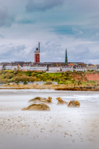 Germany, island, North Sea, Helgoland, dune, beach, gray seals, lighthouse