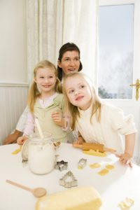Christmas, kitchen, mother, daughters, cookies, bake, cheerfully, amazed,