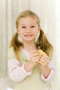 Girls, cookie dough, kneading, smile, half portrait,