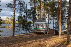Caravan by a lake in Sweden
