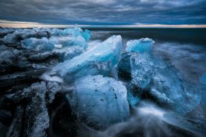 Chunks of ice in the surf at Diamond Beach, Jökulsárlón, Austurland, Iceland