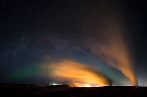 Gunnuhver steam columns at night with Milky Way and Northern Lights, Reykjanes, Iceland