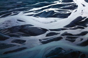 Aerial view of a branched stream in black sand, Sudurland, Iceland