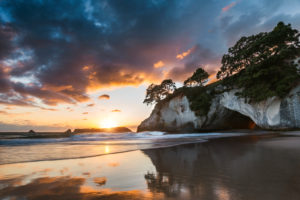Cathedral Cove with reflection at sunrise, Coromandel Peninsula, New Zealand