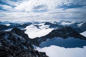 View from Galdhøpiggen over the snowy peaks of Jotunheimen, Norway