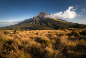 Mount Taranaki with single cloud in warm evening light, Egmont National Park, New Zealand