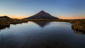 Mount Taranaki at sunrise with reflection, Pouakai Track, Egmont National Park, New Zealand
