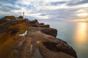Long exposure of Castlepoint lighthouse at sunrise, Castlepoint, Wellington, New Zealand