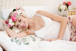 Woman, blond, floral wreath, flat, bedroom, bed,