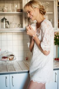 Blond woman, house, kitchen, country-style stand,