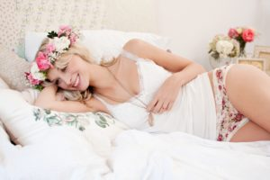 Blond woman, floral wreath, apartment, bedroom, bed,