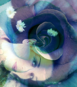 Romantically dreamy Portait of a woman with blue rose and flowers