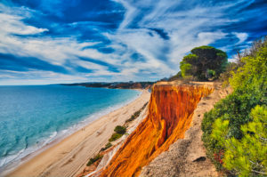 Europe, Portugal, Algarve, Litoral, Barlavento, Faro district, between Vilamoura and Albufeira, Praia da Falesia, cliffs and beach, picturesque formations, made of yellow and reddish brown limestone and sandstone