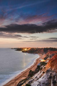 Europe, Portugal, Algarve, Litoral, Barlavento, District Faro, between Vilamoura and Albufeira, Olhos de Agua, sunset on the cliff, portrait format