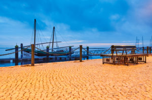 Europe, Portugal, Algarve, Litoral, Sotavento, district Faro, Olhao, promenade at the market halls, historic fishing boat, Atlantic crossing 1808, landmark, Caique Bom Sucesso, blue hour