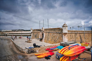Europe, Portugal, Algarve, Litoral, Barlavento, Felsalgarve, District Faro, Lagos, Forte Ponta da Bandeira, with colorful kayaks in the foreground