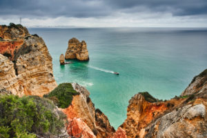 Europe, Portugal, Algarve, Litoral, Barlavento, Felsalgarve, Faro District, Lagos, the Ponta da Piedade coastline, offshore rock reef and small motor boat