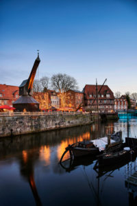 City view, Lüneburg, old town, water district, Am Stintmarkt, Am Fischmarkt, The Old Crane, landmark, illuminated, Christmas, Christmas market, night shot, portrait format
