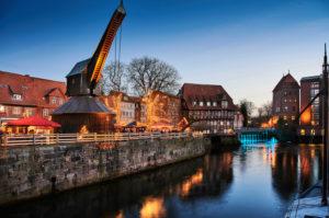 City view, Lüneburg, old town, water district, landmark, illuminated, old crane, at the Stintmarkt, at the fish market, Christmas, Christmas market, night shot,