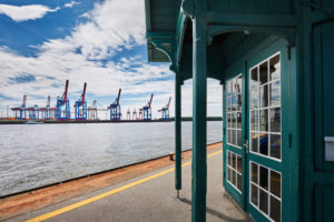 Germany, Northern Germany, Hamburg, Altona, Othmarschen, port city, seaport, the Elbe, museum harbor Oevelgönne, contrast old and new, historical Döns bus shelter on the pontoon, view to Container Terminal Burchardkai, Neumühlen ferry terminal