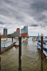 Germany, Northern Germany, port city, Hamburg, seaport, Elbe, Hamburg harbor, Überseebrücke, port basin of Niederhafen, Hafencity, view of the landmark Elbphilharmonie, portrait format