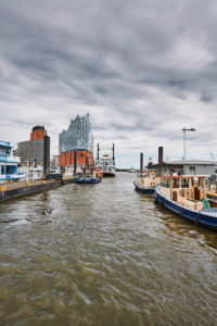 Germany, Northern Germany, port city, Hamburg, seaport, Elbe, Hamburg harbor, Überseebrücke, harbor basin, view of Hafencity and the landmark Elbphilharmonie, portrait format