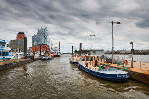 Germany, Northern Germany, port city, Hamburg, seaport, Elbe, Hamburg harbor, Überseebrücke, harbor basin, workshop ships at the pier, view of Hafencity and the landmark Elbphilharmonie