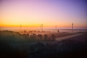 Landscape, Elbe Valley, Germany, Northern Germany, Lower Saxony, Elbe foreland near Hohnstorf, aerial view at sunrise, golden hour, colored sky, meadows in the morning mist, wind turbines
