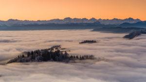Sunrise over the sea of fog on the Uetliberg near Zurich