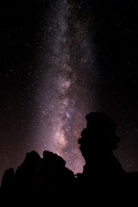 Night landscape with the Milky Way. Beautiful nature outdoors with stars and colors in the sky