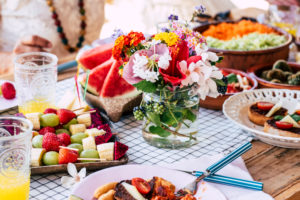 Close up of table full of seasonal fruits and vegetables for a healthy lifestyle and diet nutrition concept - coloured food on the table