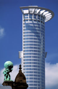 Architecture Contrast, Modern and new: DG Bank Building, old: the Atlas Statue on the Main Railroad Station, Frankfurt am Main, Germany,