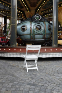 Chair in front of a carousel