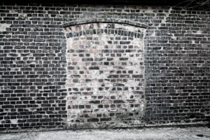Brick wall, door curve, bricked up,