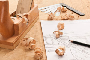 Wooden slicer, wood shavings, plan of boat,