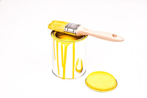 paint tin, wooden paint-brush, colour, yellow,