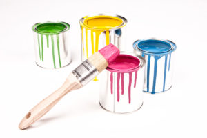 Colour tins, wooden paintbrushes, colours, yellow, red, blue, green,