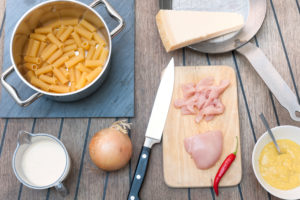 Cooking, noodles, chilli, chicken breast fillet, onion, knife, kitchen knife, saucepan, frying pan, Parmesan, small board, cutting board, menu, ingredients,