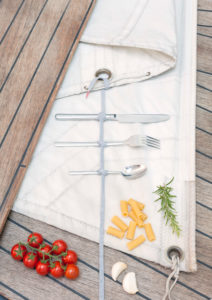 Ship deck, teak, sail, cutlery, knife fork, spoon, tomato, garlic, vegetables, rosemary, noodles,