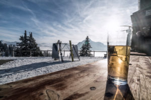 mountain landscape on the Tegelberg (mountain) in South Germany in winter, break on alpine hut, drink on a wooden table