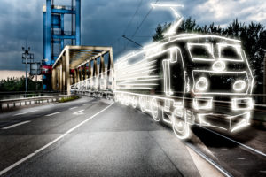 light drawing of a freight train on a bridge,