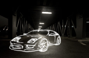 light drawing of a sports car on a bridge at night,