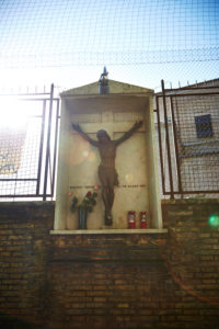 Statue of Christ on the cross, wayside cross, Rome, Italy